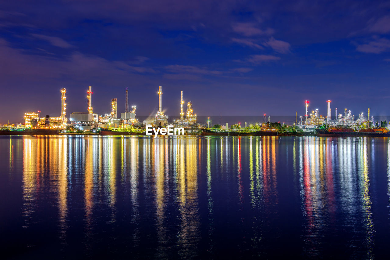 industry, water, fuel and power generation, sky, waterfront, oil industry, nature, architecture, reflection, built structure, factory, no people, illuminated, cloud - sky, building exterior, refinery, outdoors, night, sea