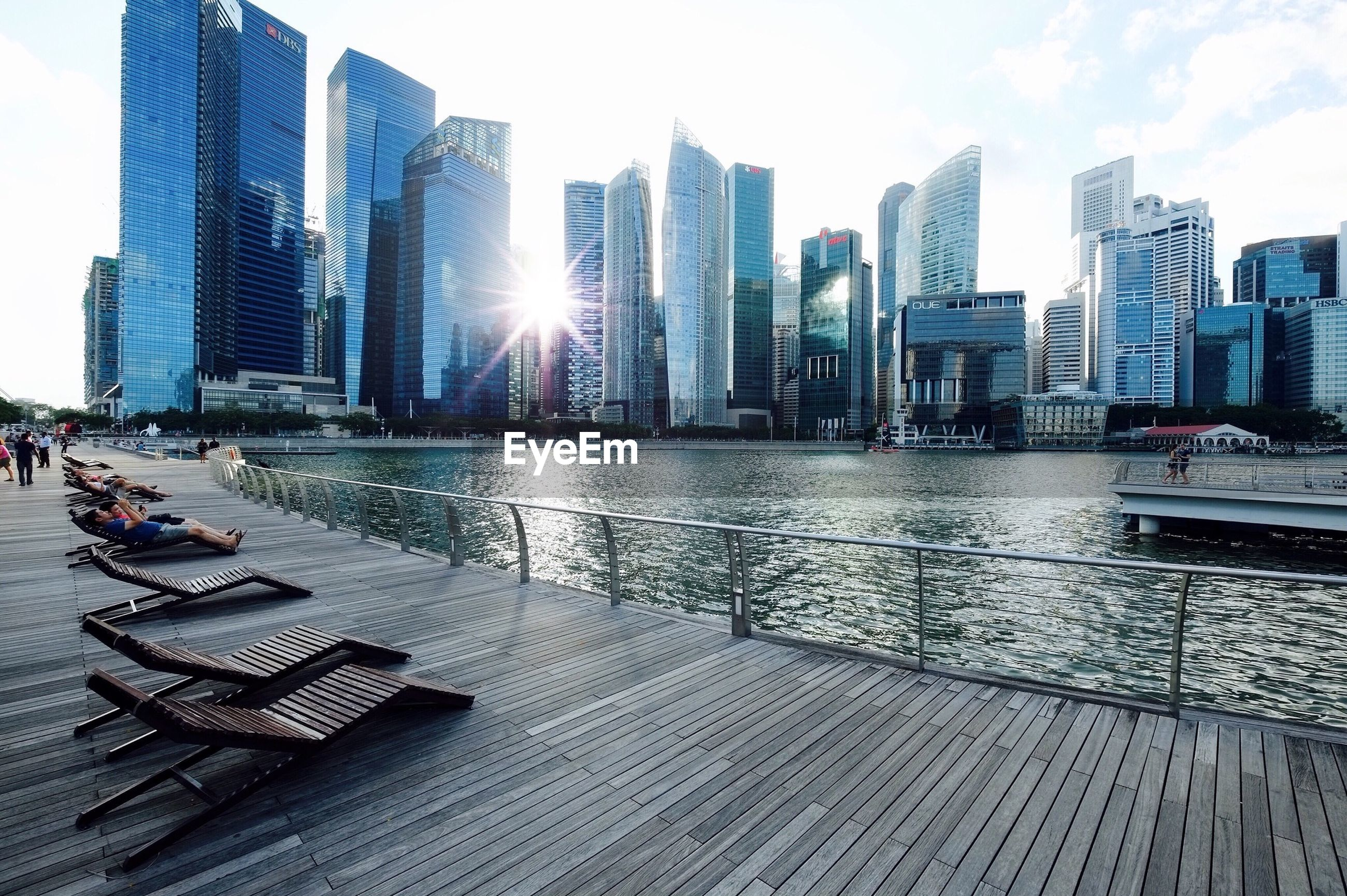 building exterior, city, skyscraper, architecture, built structure, modern, office building, tall - high, water, urban skyline, tower, cityscape, sky, city life, financial district, reflection, building, sunlight, tall, skyline