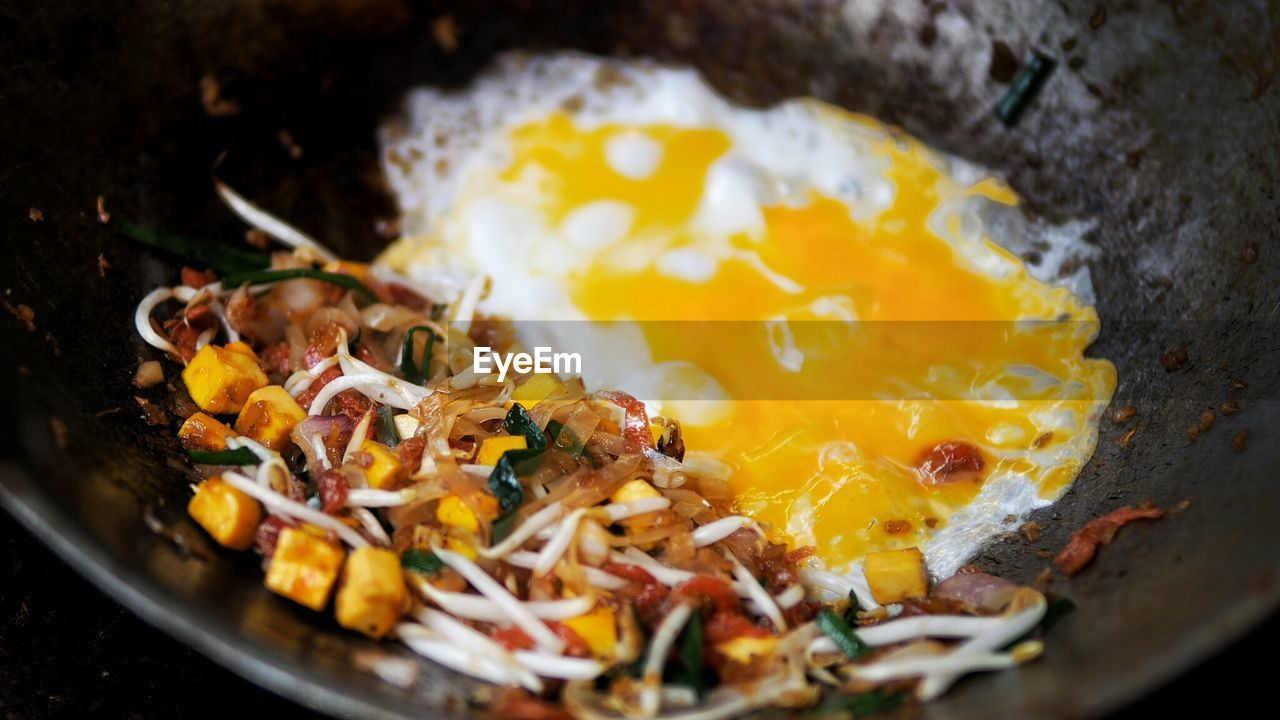Close-Up Of Pad Thai With Omelet In Cooking Pan