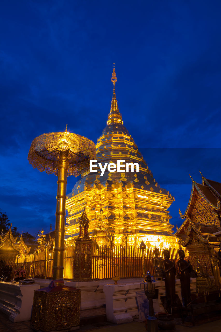 built structure, belief, architecture, religion, building exterior, place of worship, spirituality, sky, building, gold colored, illuminated, dusk, blue, travel destinations, nature, history, travel, low angle view, no people, outdoors, spire, ornate