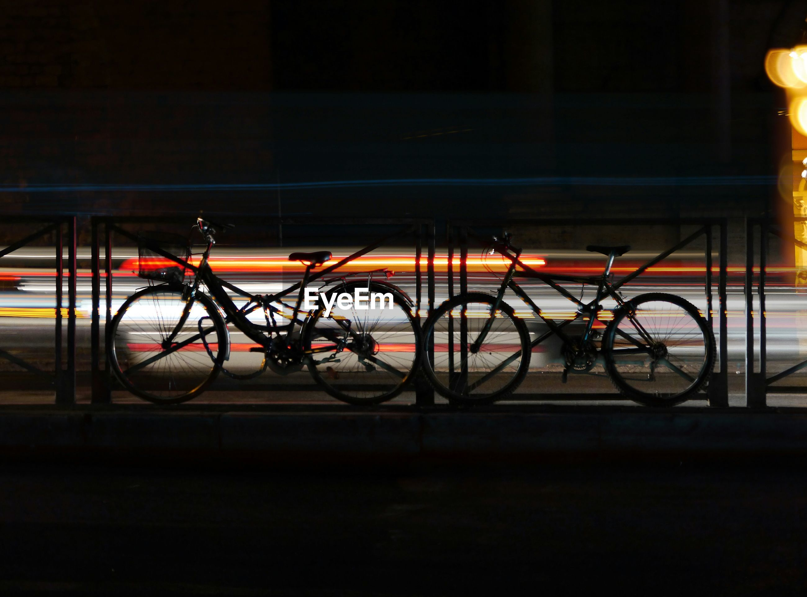 bicycle, transportation, no people, mode of transport, land vehicle, illuminated, night, outdoors, bicycle rack
