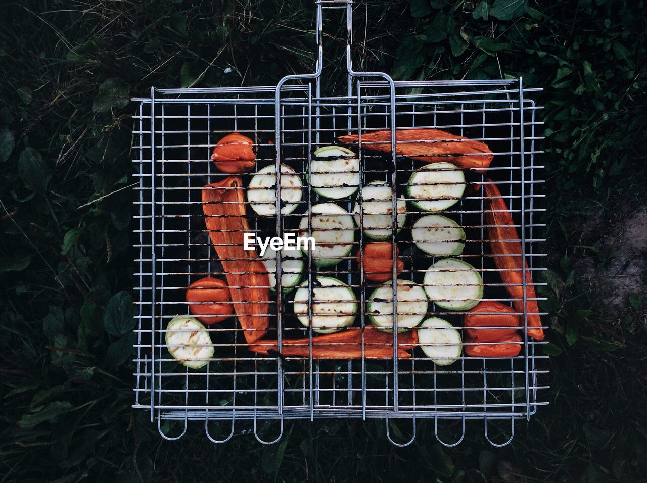 Directly Above Shot Of Vegetables In Barbecue Grill On Field