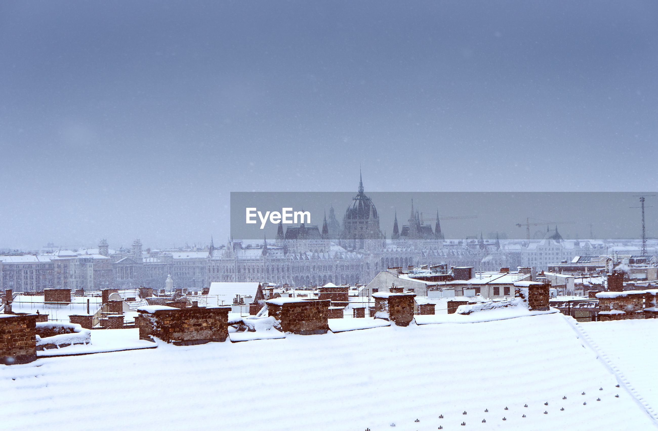 View of buildings against clear sky during winter