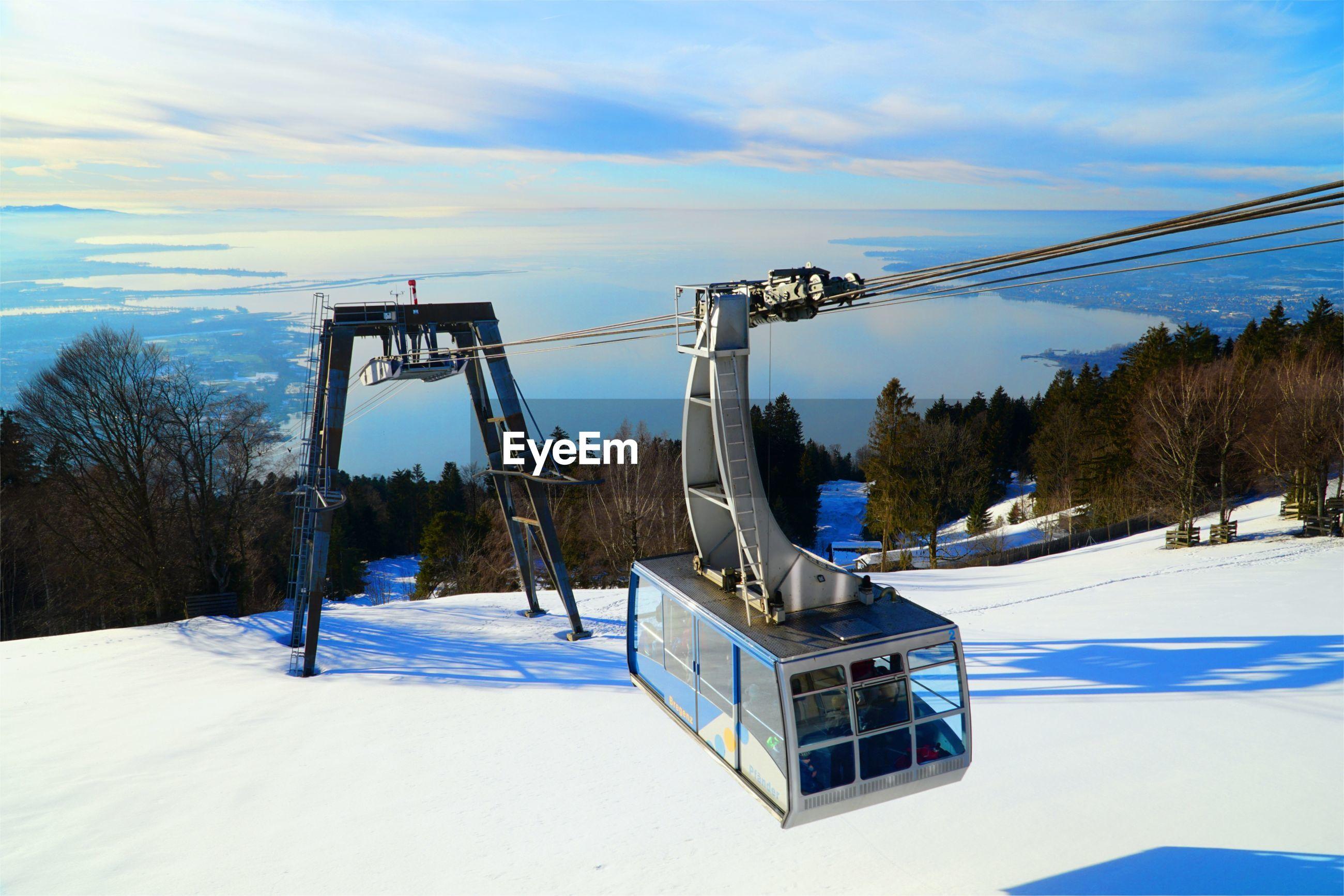 GAZEBO ON SNOW COVERED LAND AGAINST SKY