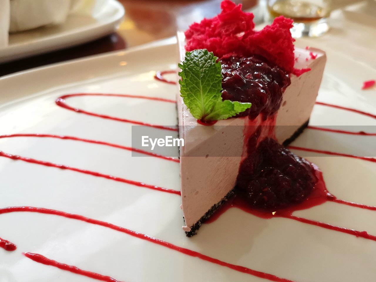 food and drink, food, sweet, sweet food, dessert, indulgence, ready-to-eat, plate, freshness, temptation, still life, close-up, berry fruit, indoors, red, no people, serving size, unhealthy eating, strawberry, baked, garnish, mint leaf - culinary, cheesecake, snack, chocolate cake
