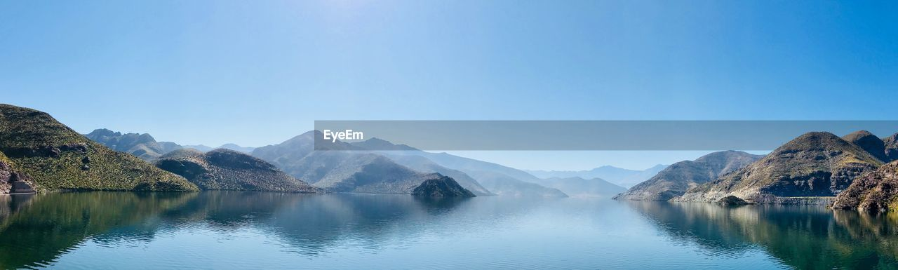 mountain, scenics - nature, sky, water, beauty in nature, tranquility, tranquil scene, mountain range, copy space, idyllic, non-urban scene, waterfront, nature, blue, day, lake, clear sky, no people, reflection, outdoors