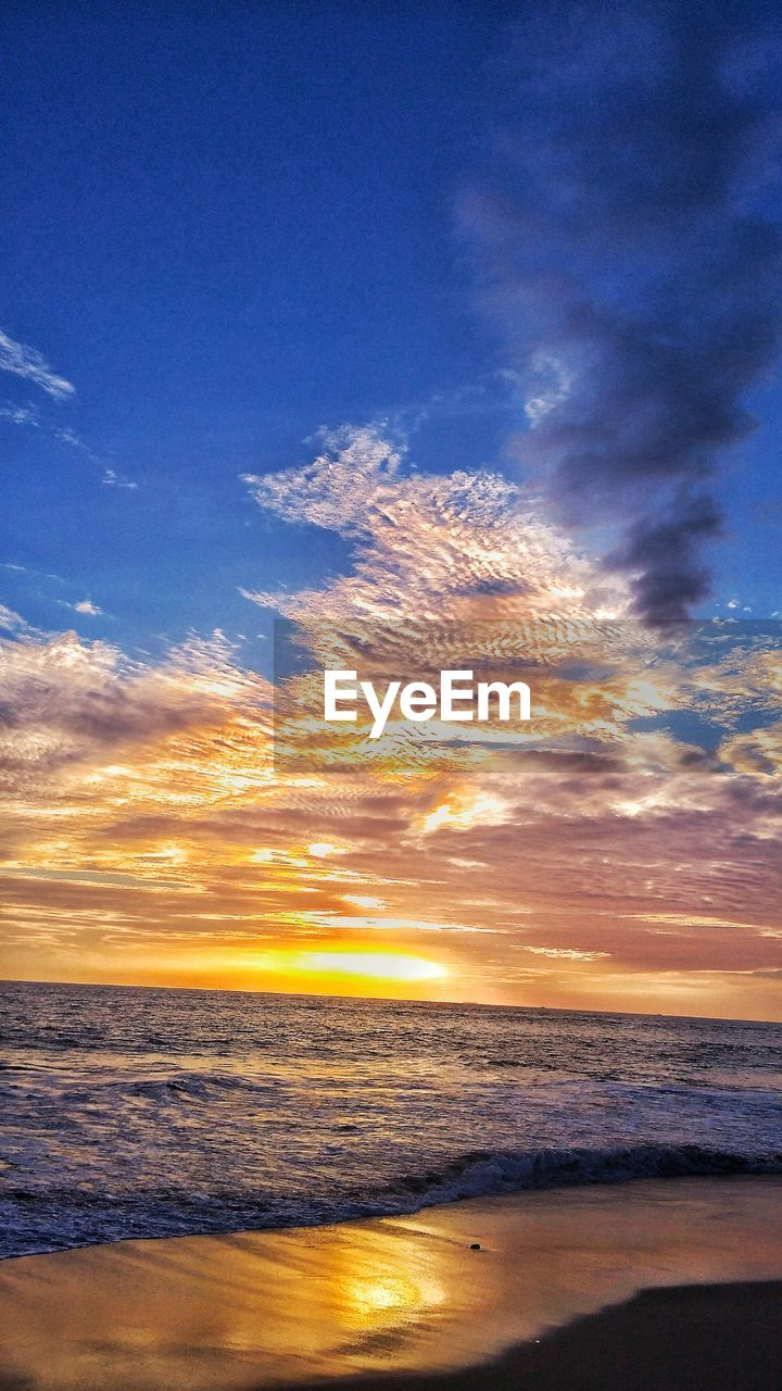 sea, sunset, scenics, beauty in nature, nature, sky, tranquility, beach, horizon over water, tranquil scene, water, no people, outdoors, vapor trail