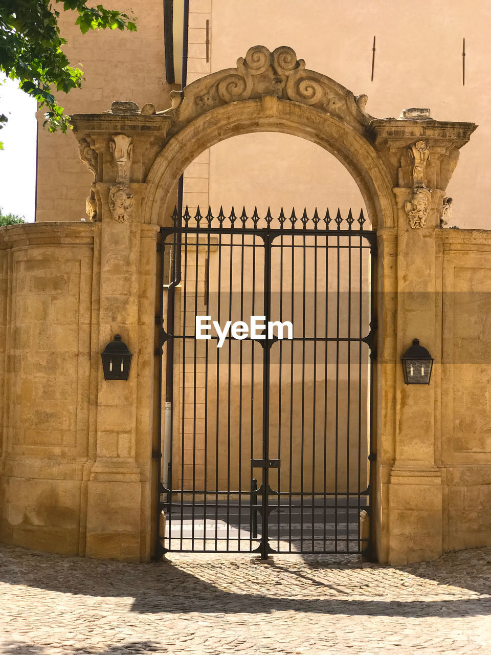 architecture, gate, arch, built structure, building exterior, history, the past, building, entrance, safety, no people, security, day, protection, nature, closed, door, travel destinations, sunlight, fence, wrought iron, outdoors, ornate, iron - metal, architectural column