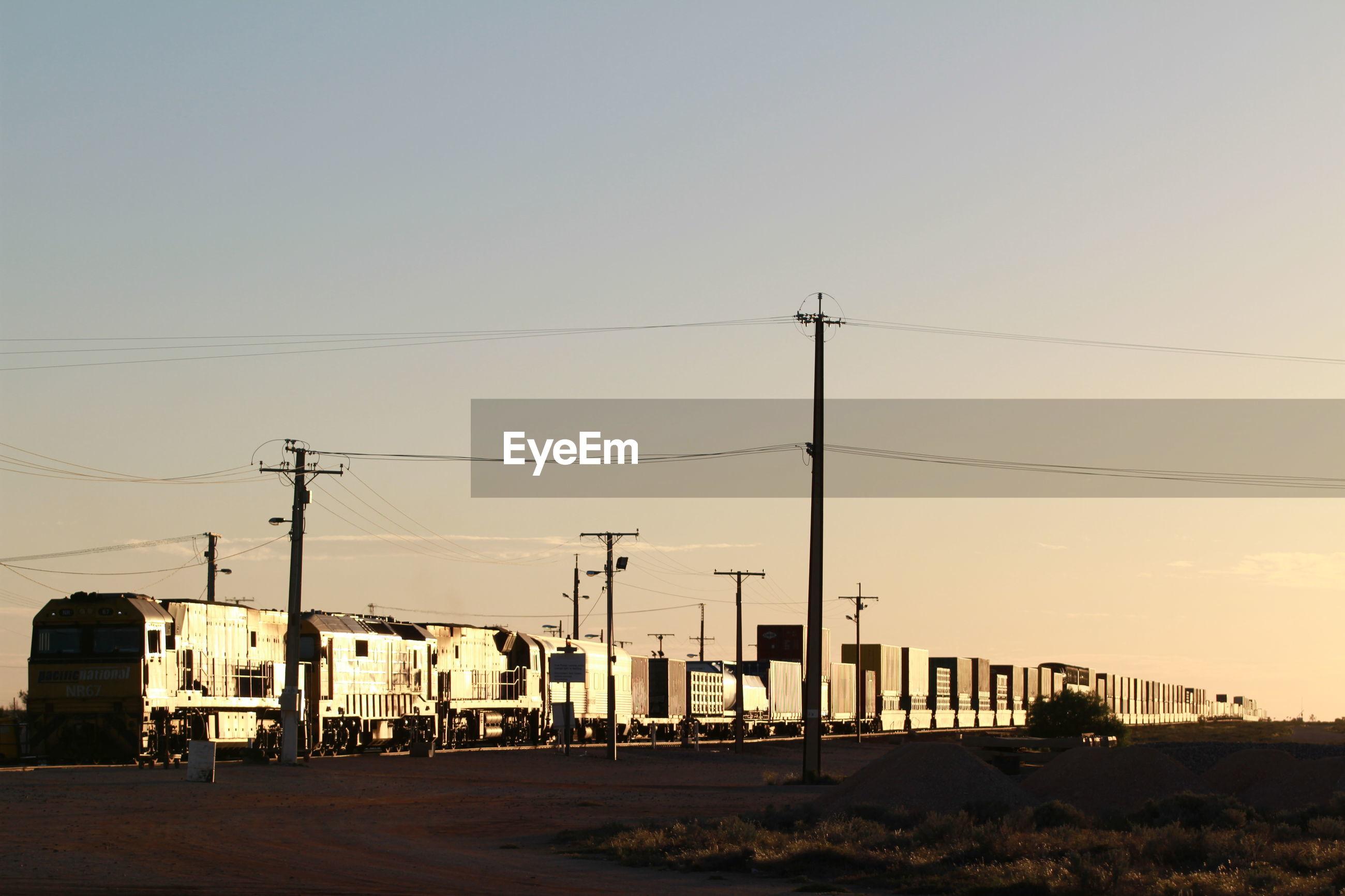 ELECTRICITY PYLON AGAINST CLEAR SKY
