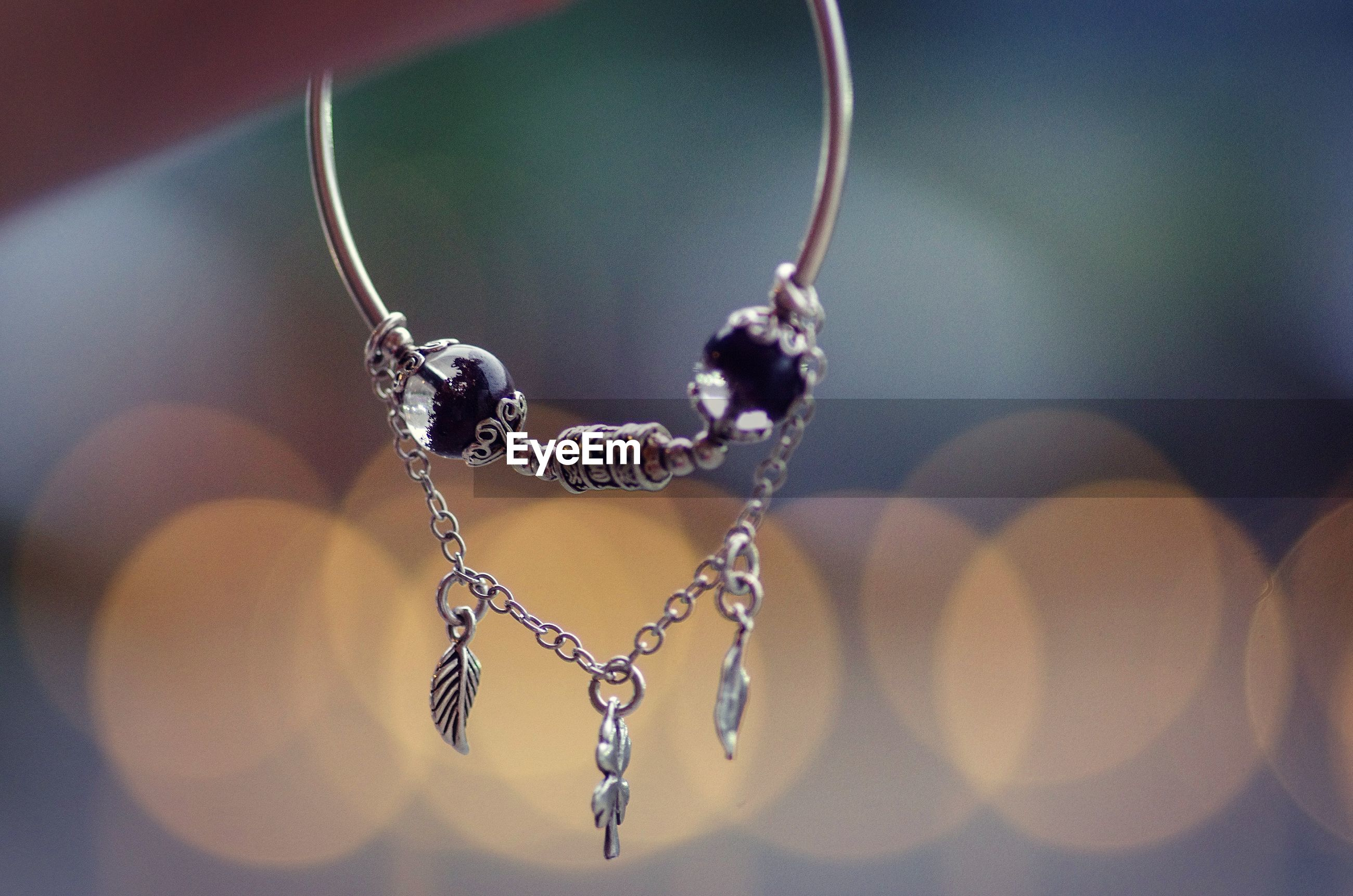 Close-up of bracelet hanging outdoors