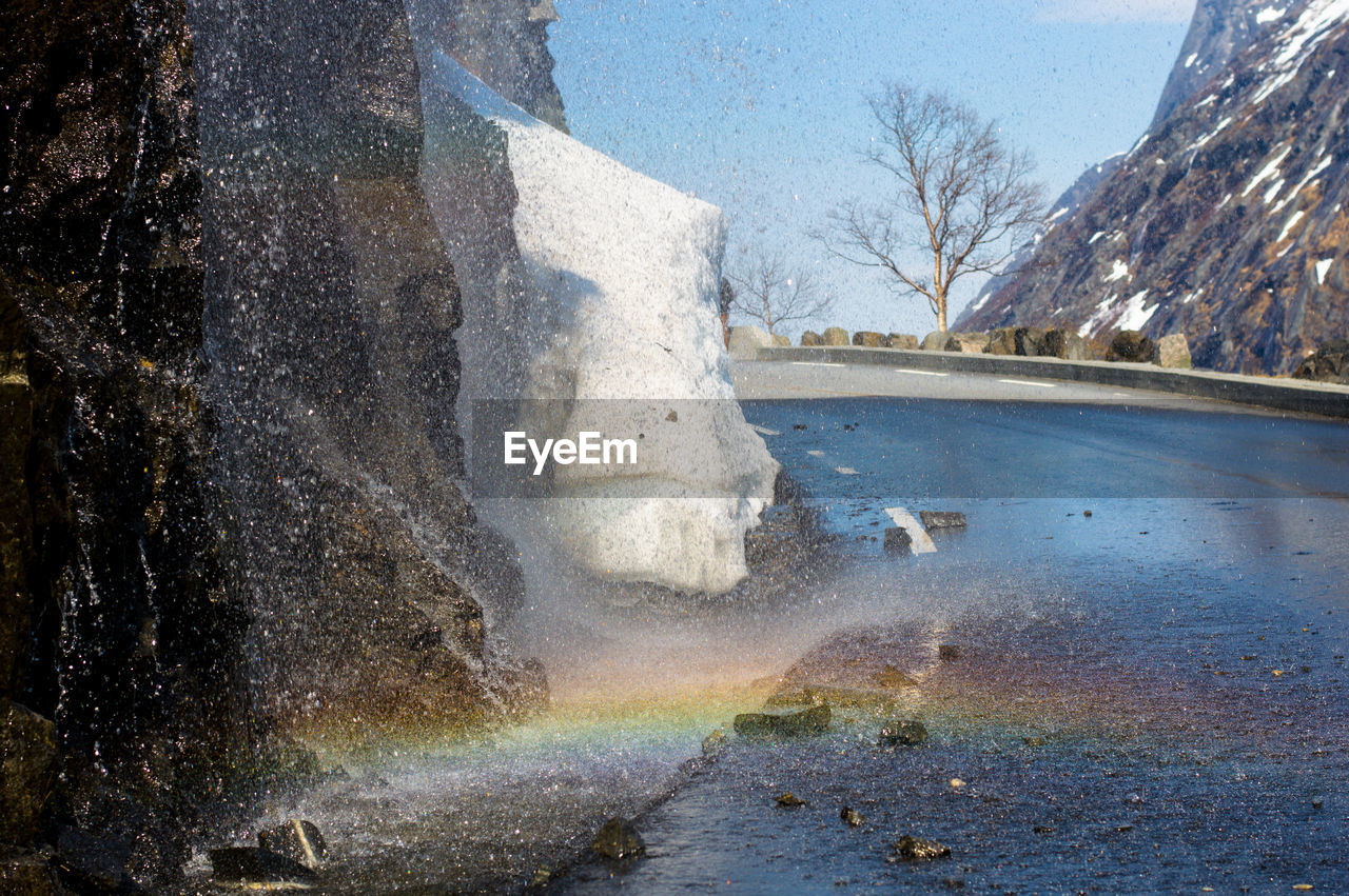 Rainbow at waterfall in winter