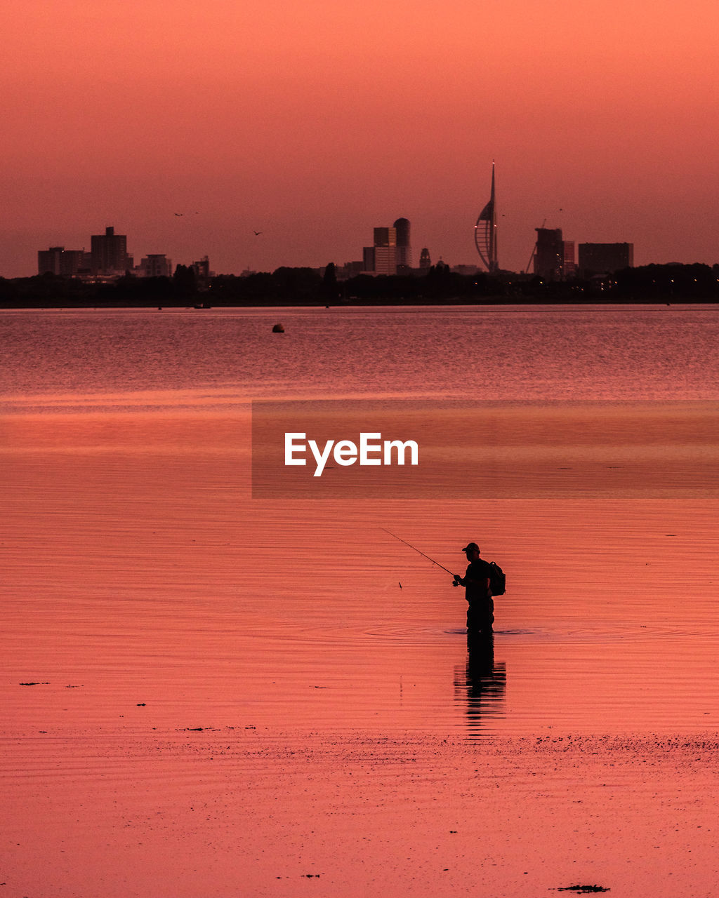 Sunset of fisherman from a hayling island, skyline and spinnaker tower / portsmouth