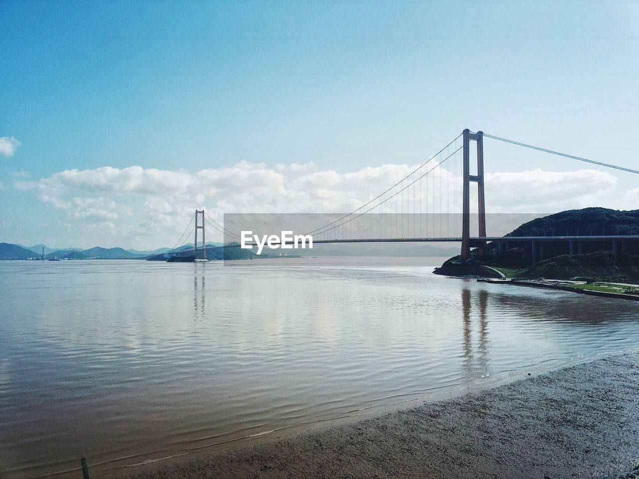 bridge - man made structure, suspension bridge, connection, transportation, engineering, architecture, built structure, sky, water, travel destinations, outdoors, river, travel, day, tourism, bridge, mountain, no people, scenics, cloud - sky, nature, city, beauty in nature