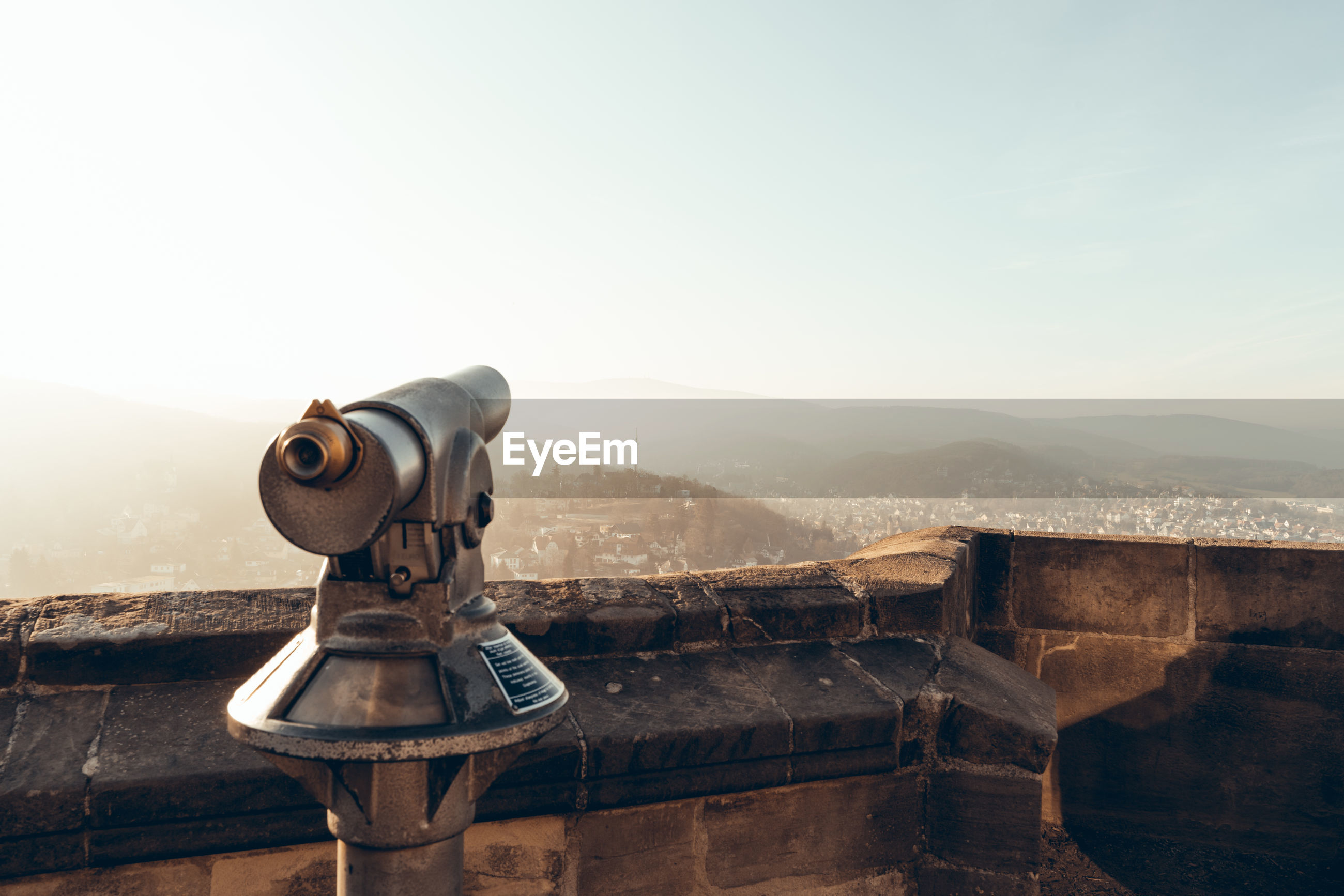 Coin-operated binoculars on mountain against clear sky
