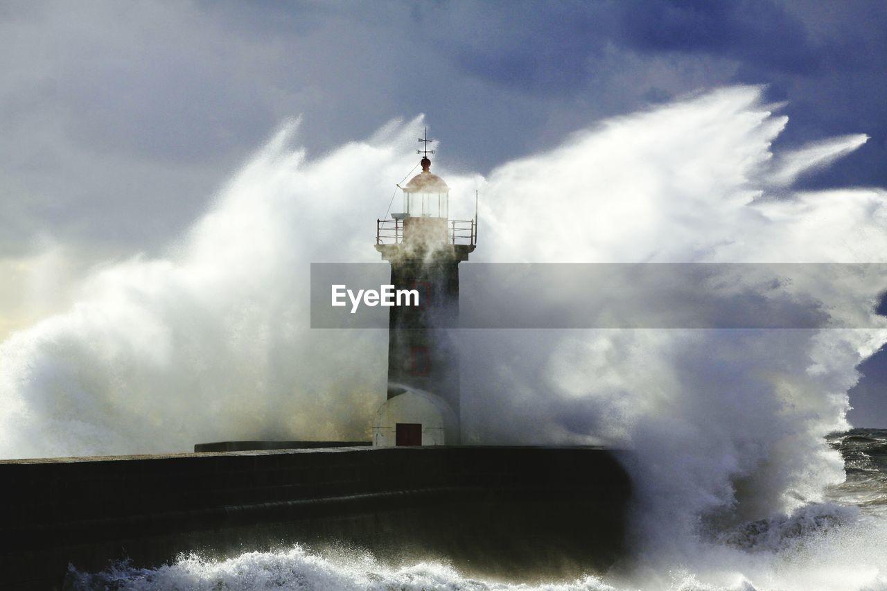 Water splashing on lighthouse