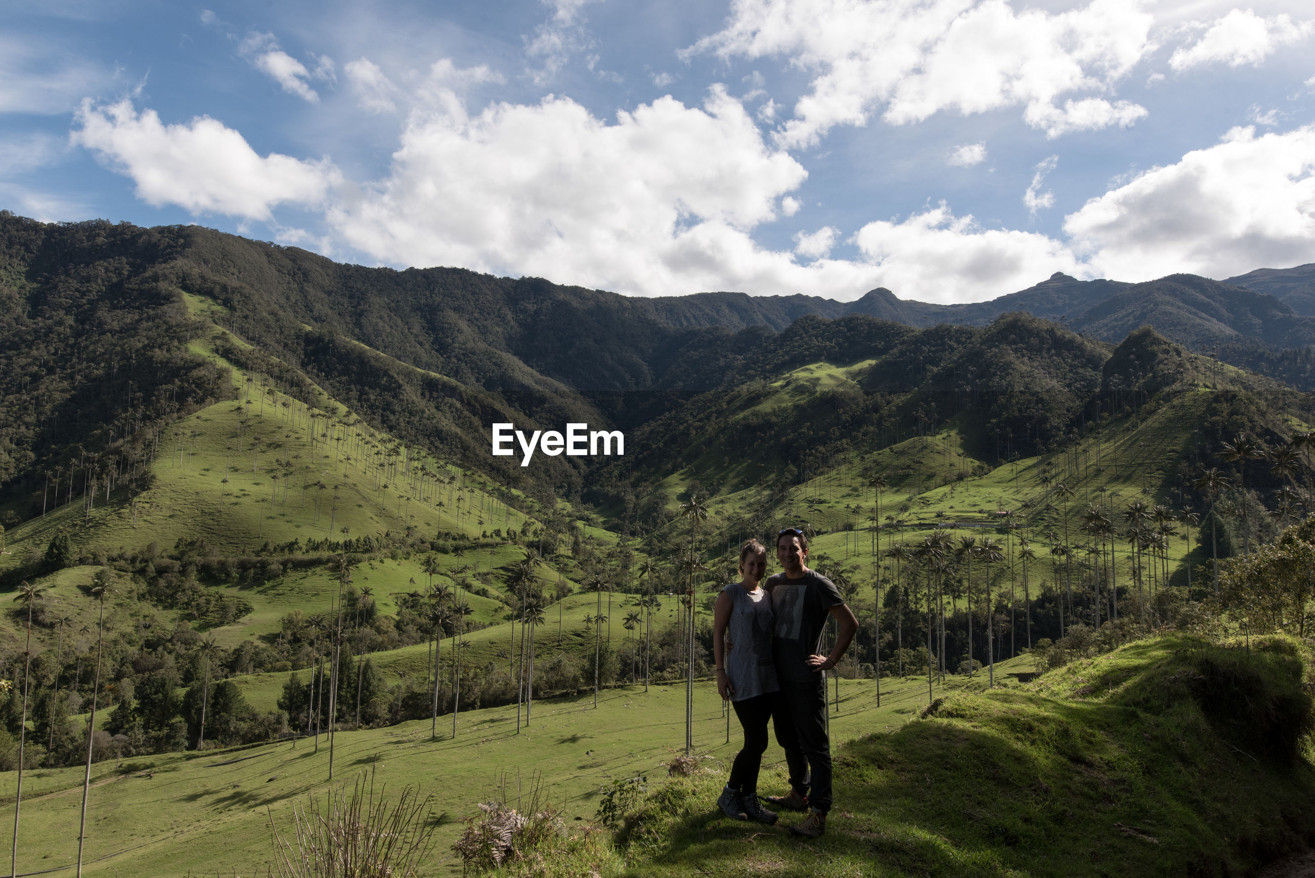 Portrait of couple standing at cocora valley against sky