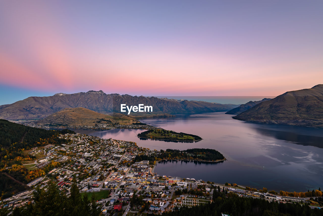 Aerial view of townscape and lake during sunset