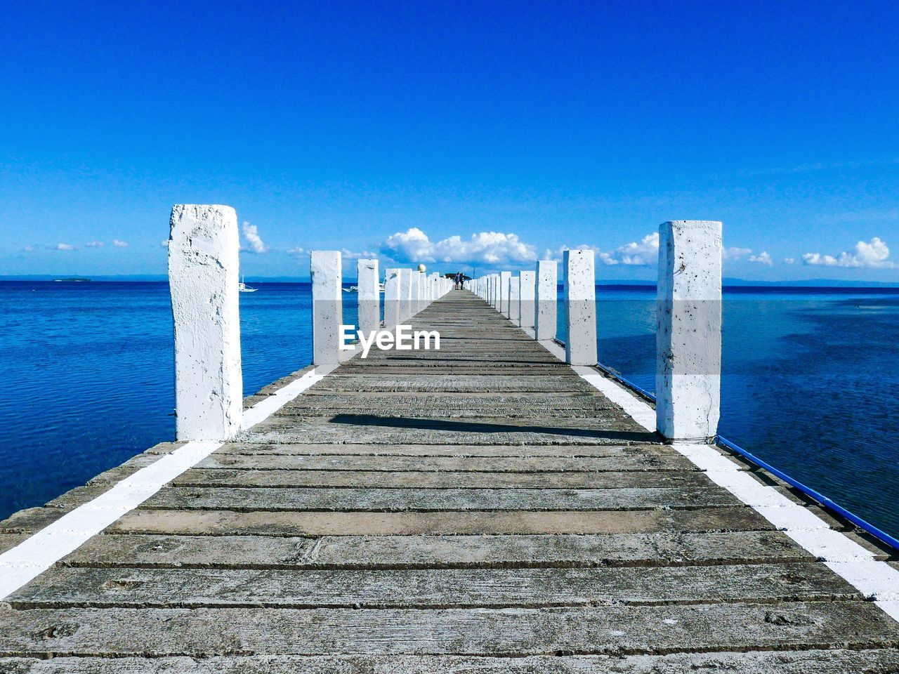 sea, water, pier, the way forward, blue, nature, jetty, wood - material, tranquil scene, day, no people, tranquility, outdoors, scenics, horizon over water, sky, beach, wood paneling, beauty in nature