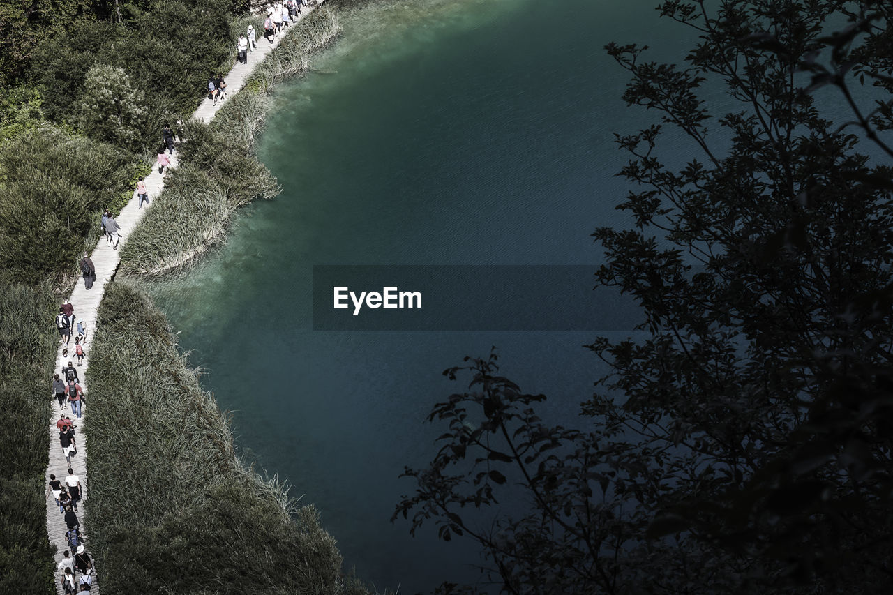 High angle view of people walking on boardwalk at plitvice lakes national park