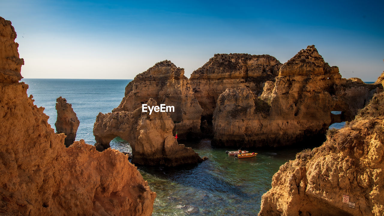 water, rock, sea, rock formation, rock - object, solid, sky, scenics - nature, beauty in nature, land, nature, tranquility, tranquil scene, horizon over water, geology, cliff, horizon, physical geography, non-urban scene, no people, outdoors, eroded, formation