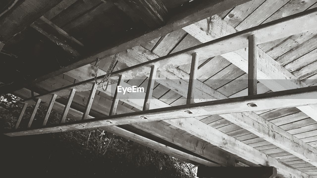 architecture, built structure, low angle view, indoors, no people, wood - material, staircase, ceiling, roof beam, steps and staircases, roof, day, building, old, railing, metal, weathered, abandoned, pattern