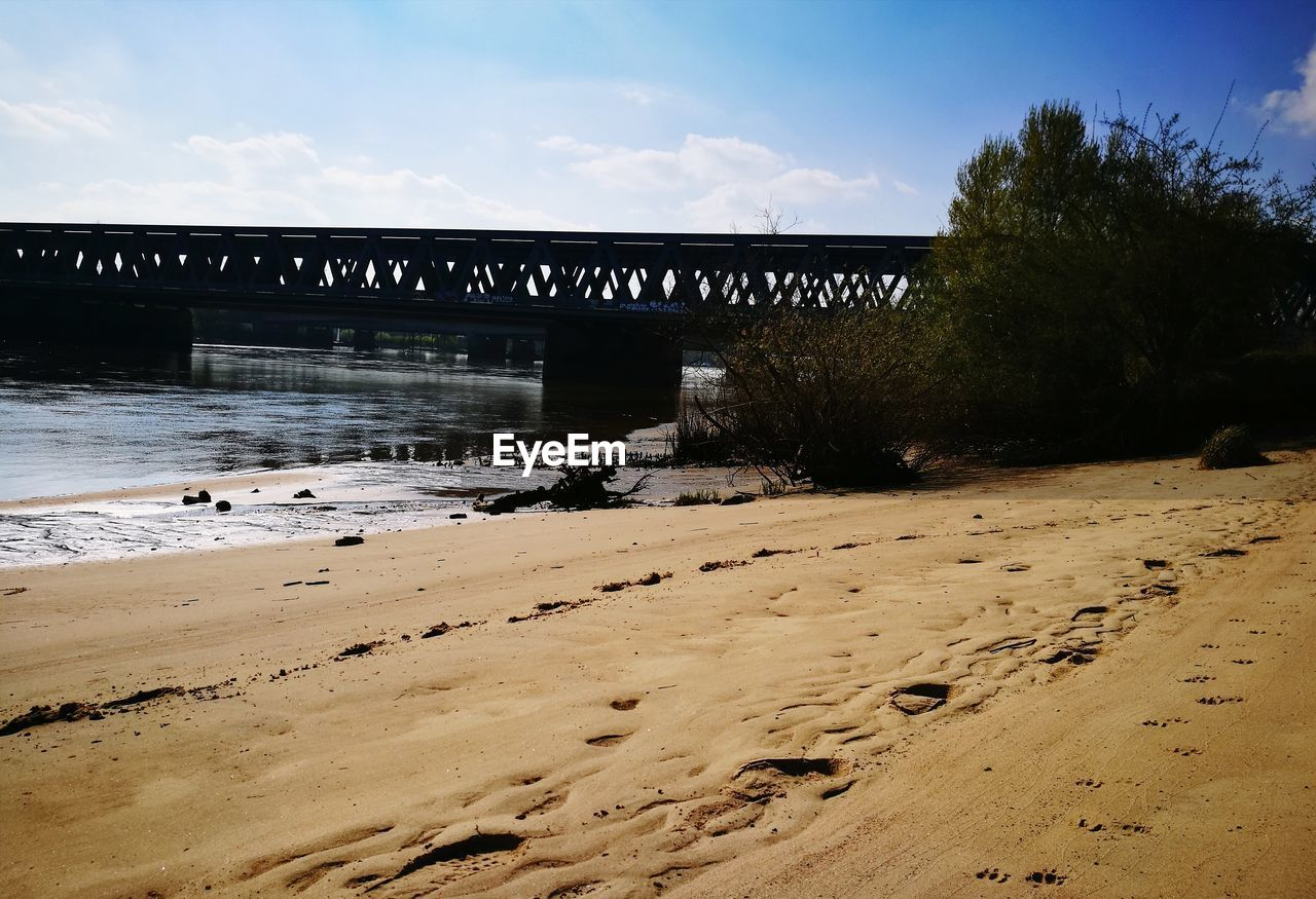 bridge - man made structure, architecture, built structure, sky, connection, cloud - sky, water, nature, no people, day, outdoors, sand, beach, tree