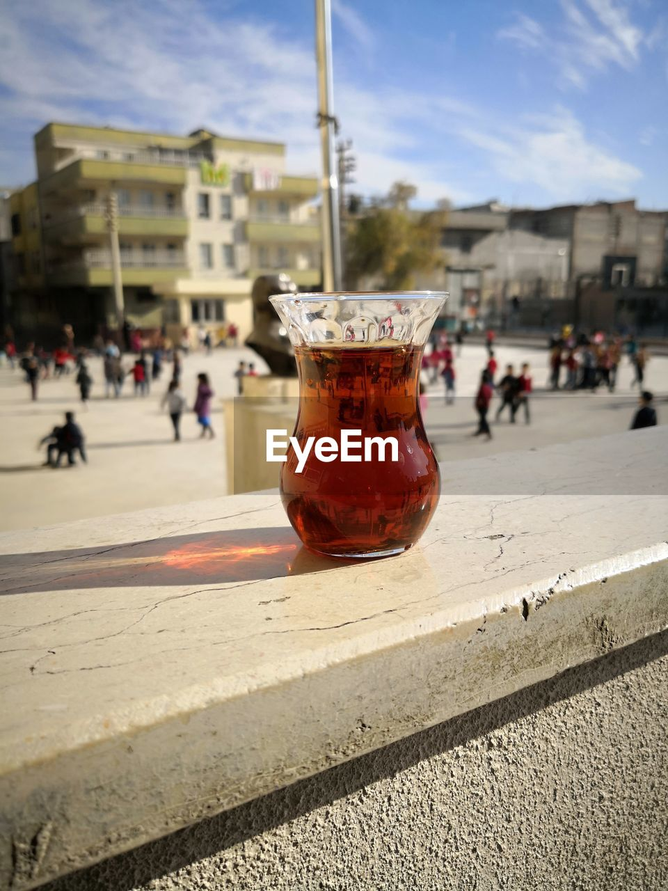 drink, food and drink, refreshment, incidental people, drinking glass, outdoors, close-up, building exterior, architecture, city, day, cold temperature, freshness, sky, mint tea, people
