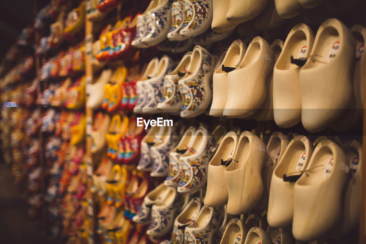 choice, variation, large group of objects, arrangement, for sale, in a row, indoors, retail, store, no people, shopping, retail display, abundance, collection, shoe, selective focus, still life, order, sale, multi colored, consumerism