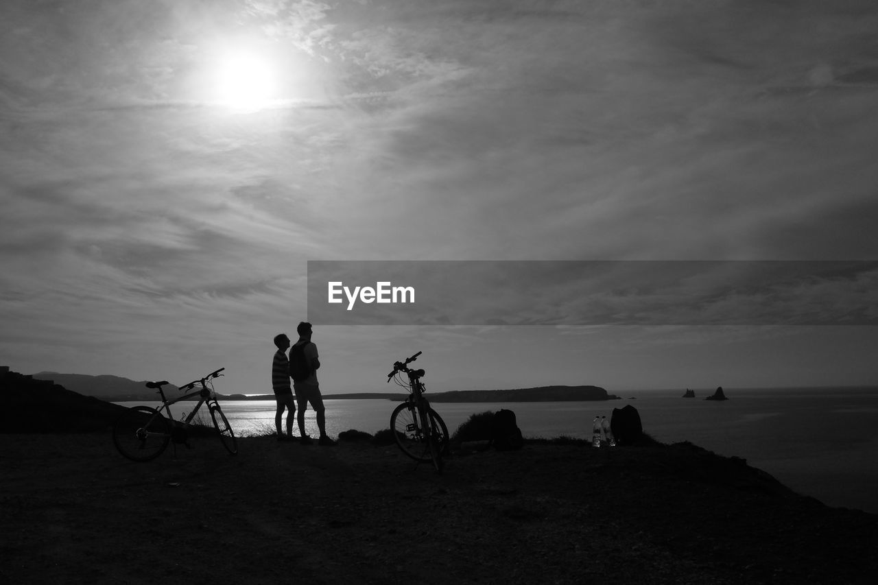 bicycle, sky, sun, sunset, silhouette, nature, cloud - sky, real people, cycling, sunlight, leisure activity, men, outdoors, transportation, togetherness, vacations, two people, scenics, water, sea, lifestyles, beauty in nature, women, day, friendship, people