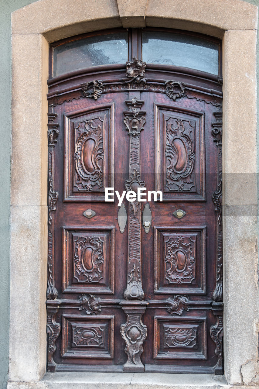 entrance, door, architecture, closed, building, building exterior, built structure, safety, day, protection, no people, security, wood - material, design, front door, art and craft, outdoors, pattern, craft, wood, ornate, carving