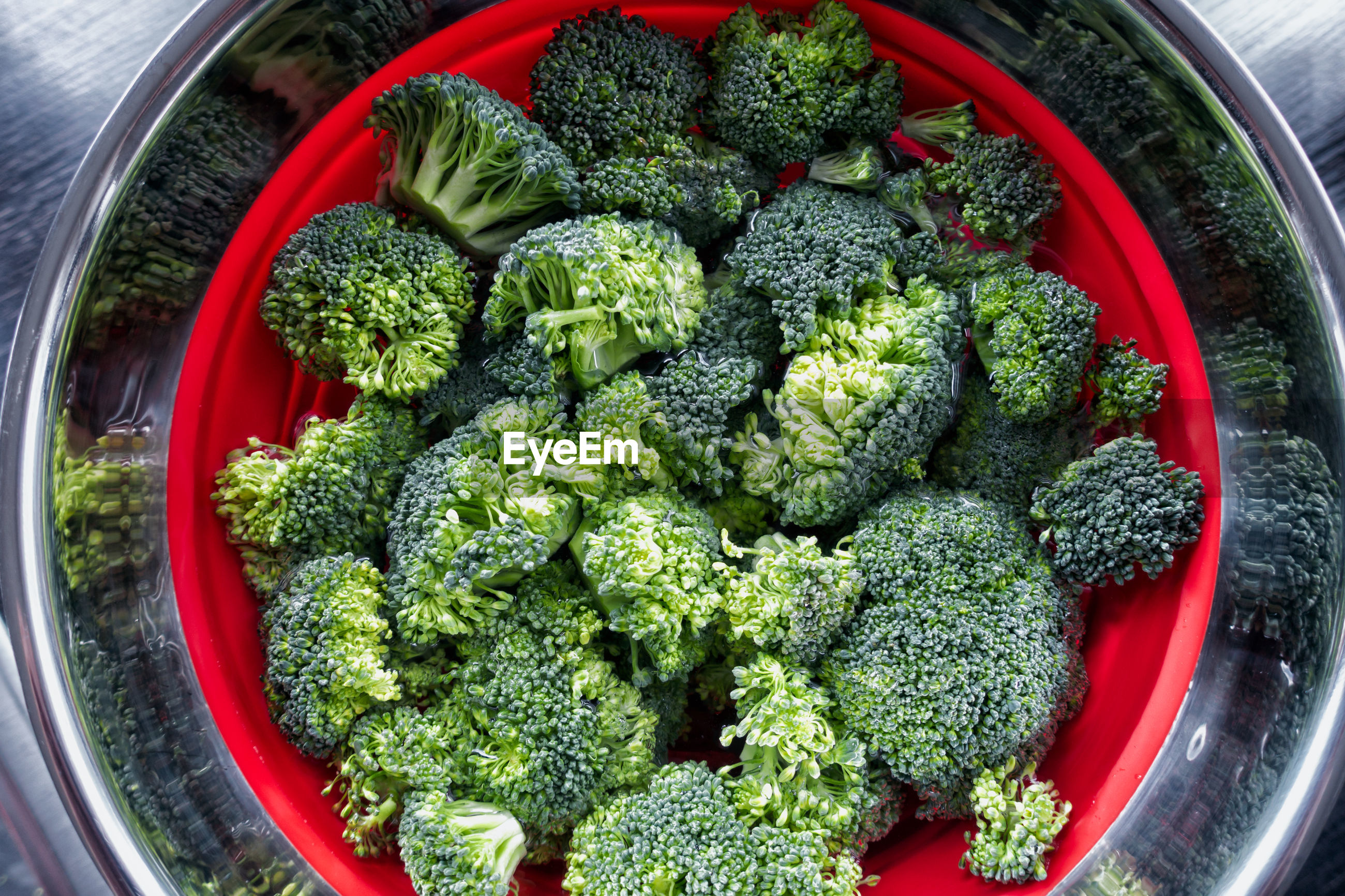 High angle view of broccoli in colander