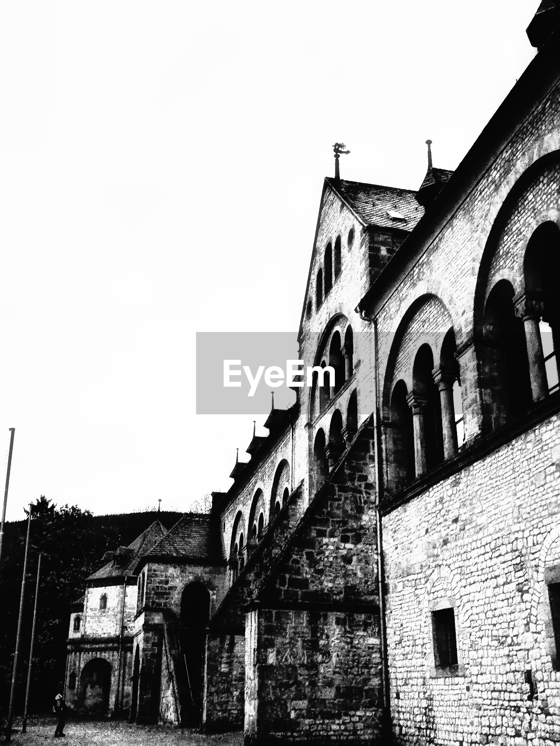 building exterior, built structure, low angle view, architecture, outdoors, day, clear sky, arch, history, sky, no people, place of worship