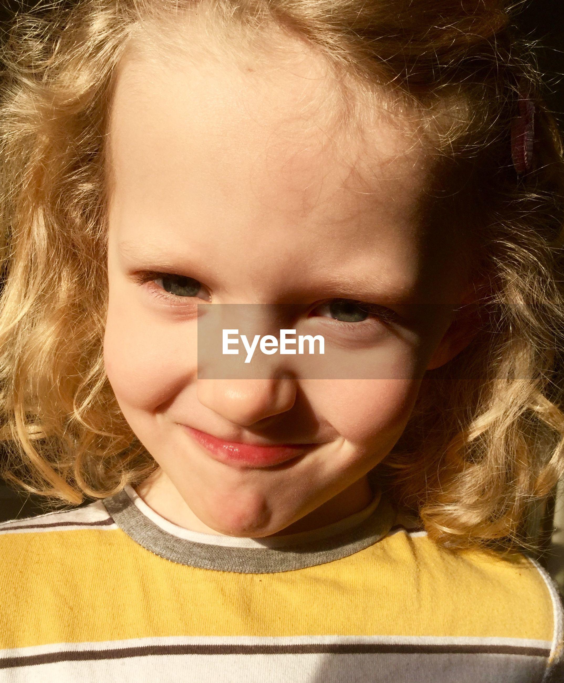 Portrait of little girl making face