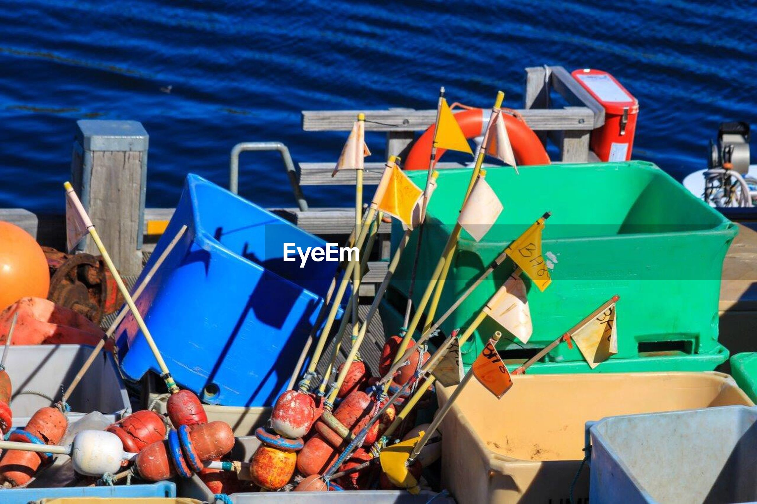 Fishing equipment with containers in boat on sea