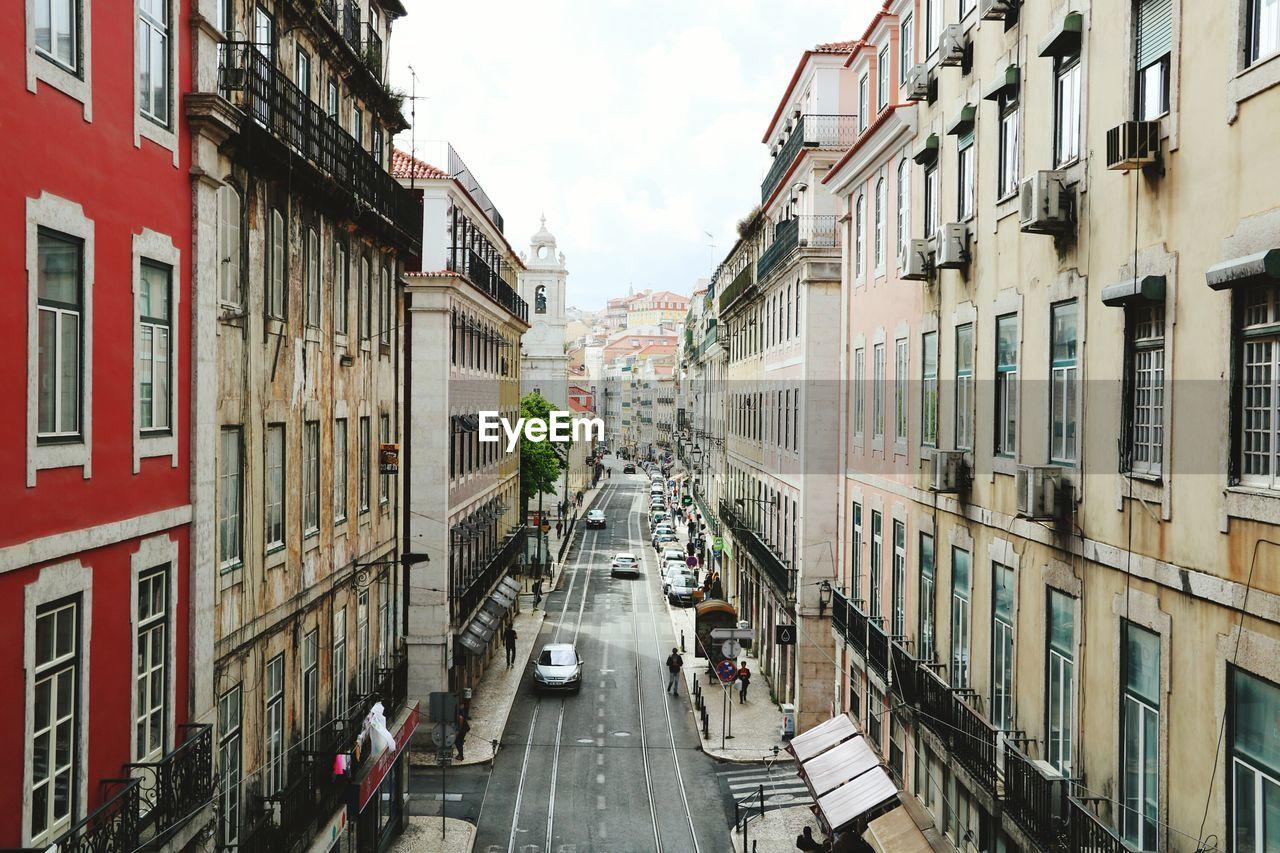 Street Amidst Residential Buildings Against Sky