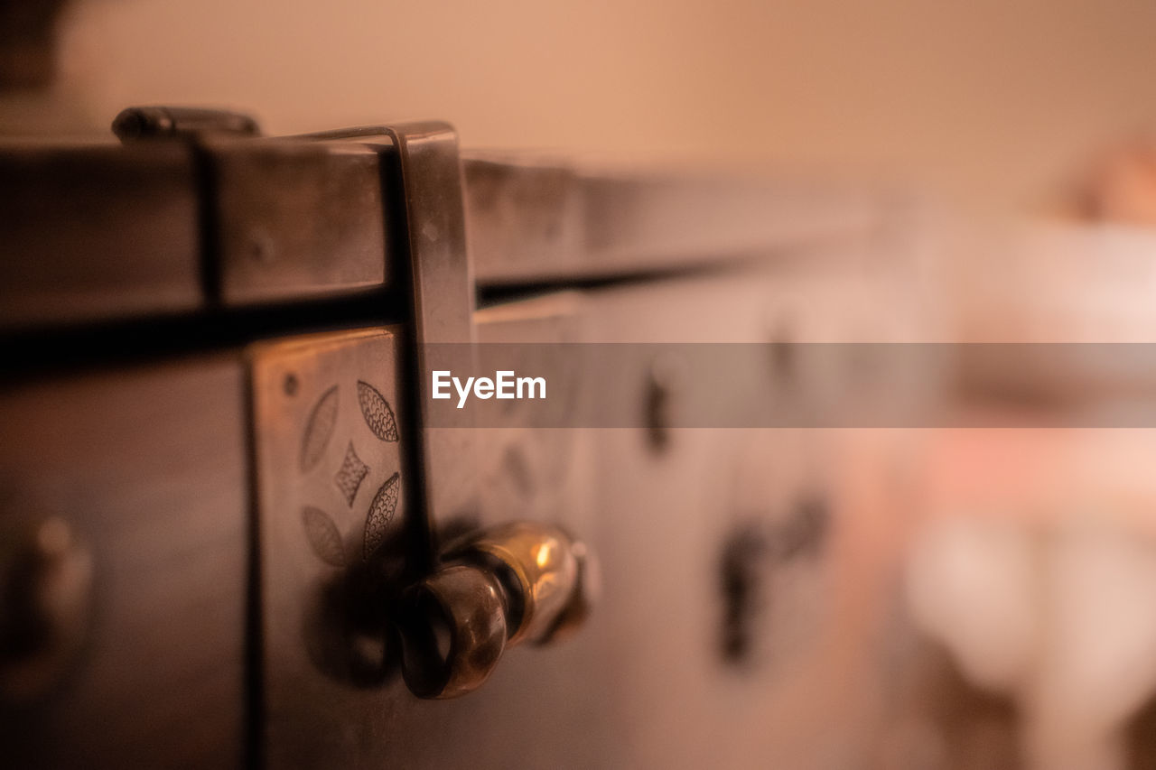selective focus, close-up, protection, metal, indoors, no people, security, safety, door, wood - material, entrance, lock, old, text, communication, art and craft, in a row, drawer, focus on foreground