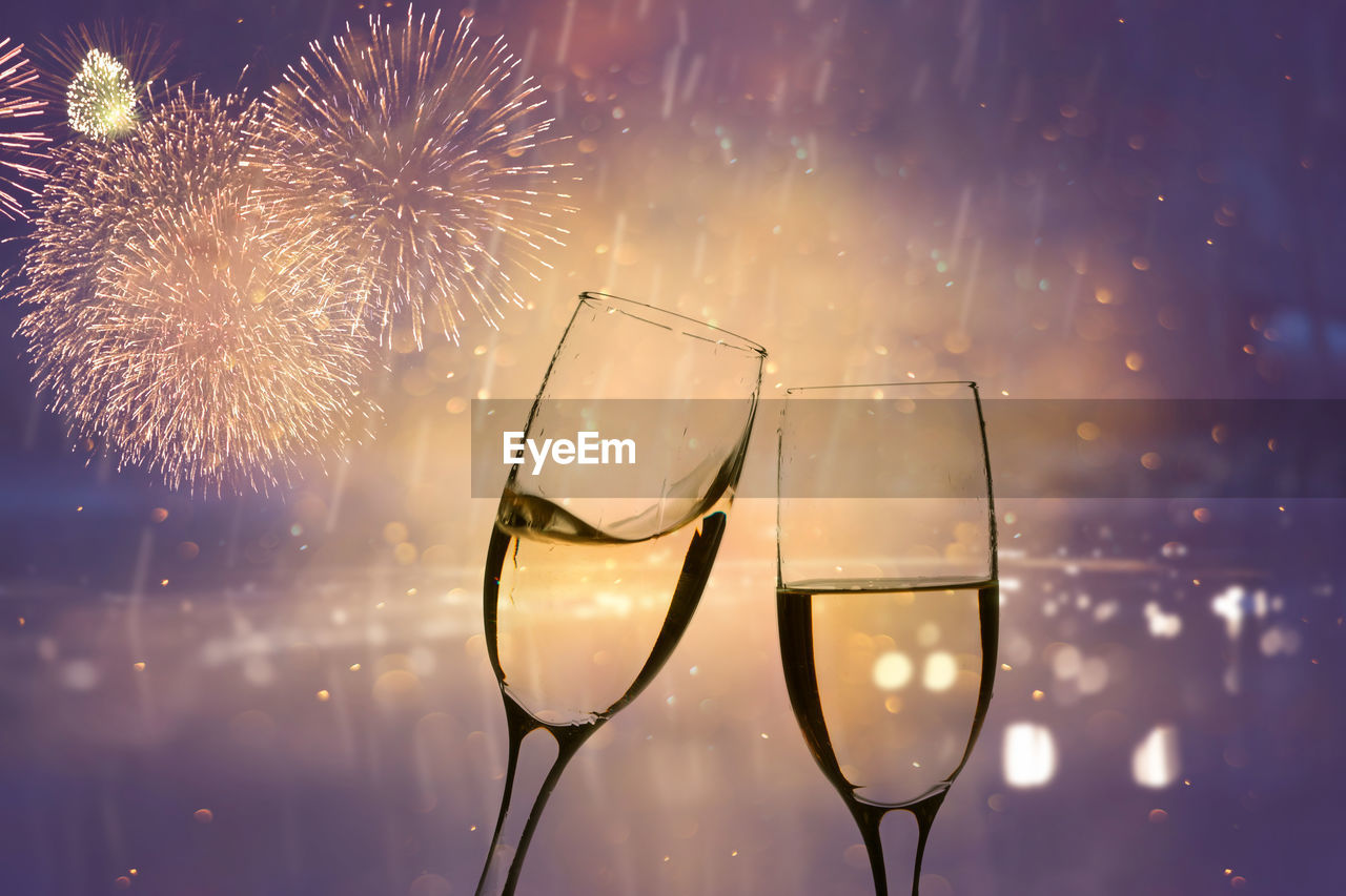 celebration, illuminated, glass, firework, motion, firework display, event, nature, drink, no people, sky, night, long exposure, glass - material, wine, focus on foreground, refreshment, alcohol, glowing, light, firework - man made object