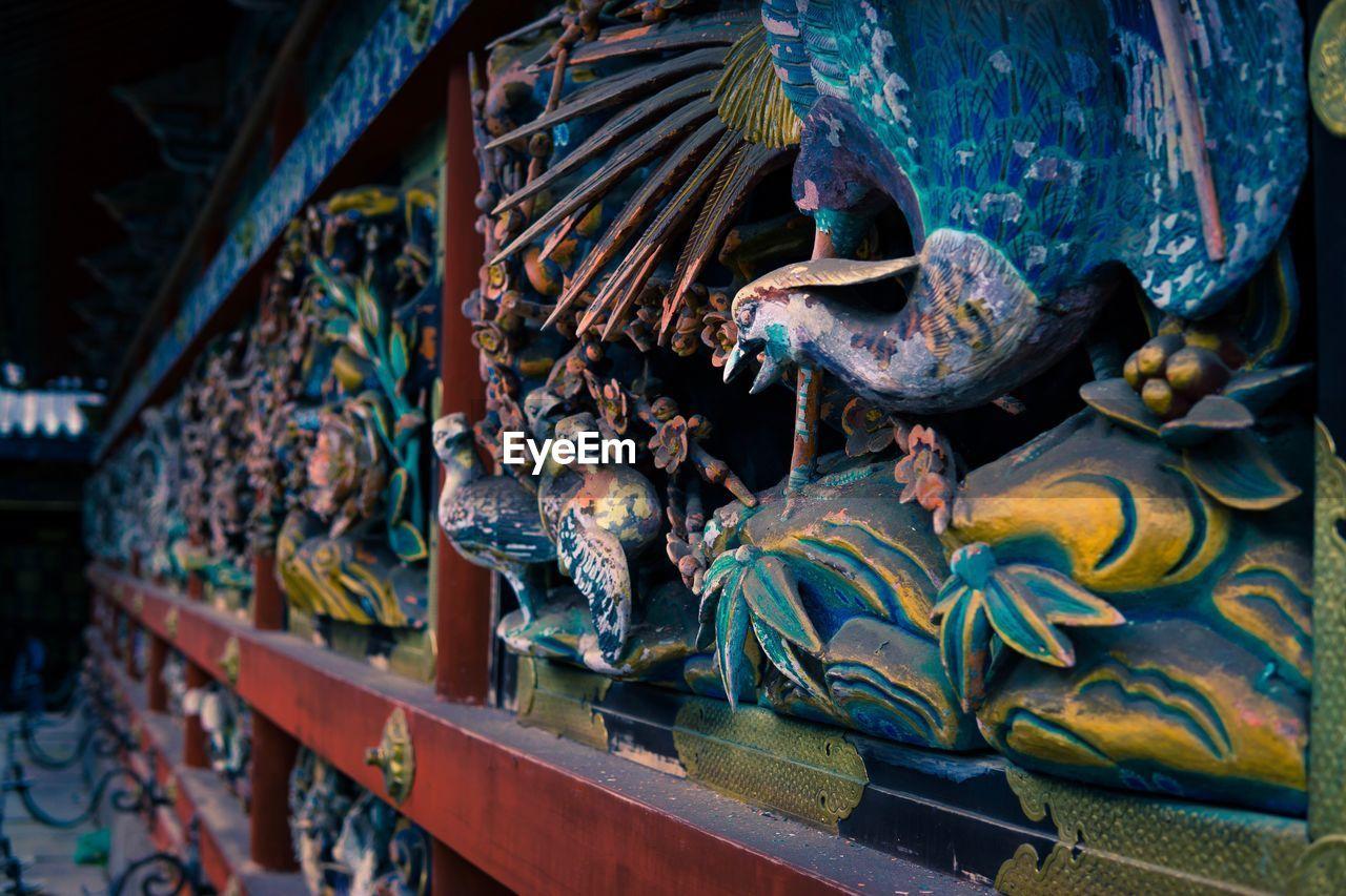 Close-Up Of Metallic Carvings In Gate