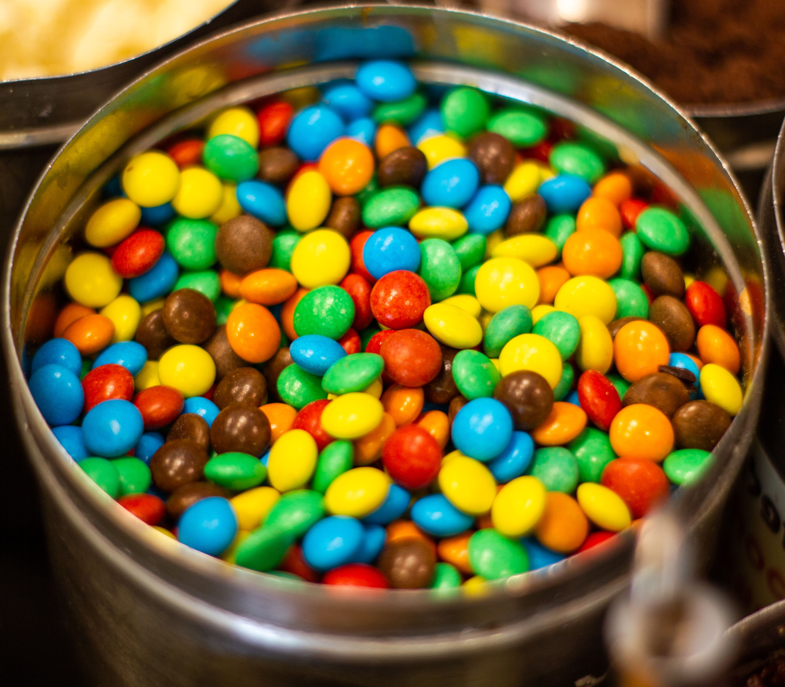 High angle view of multi colored candies in bowl