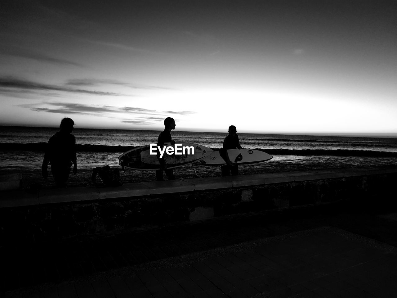 water, sky, sea, real people, men, silhouette, nature, transportation, leisure activity, group of people, horizon, beauty in nature, nautical vessel, people, lifestyles, horizon over water, scenics - nature, sitting, beach, outdoors, looking at view