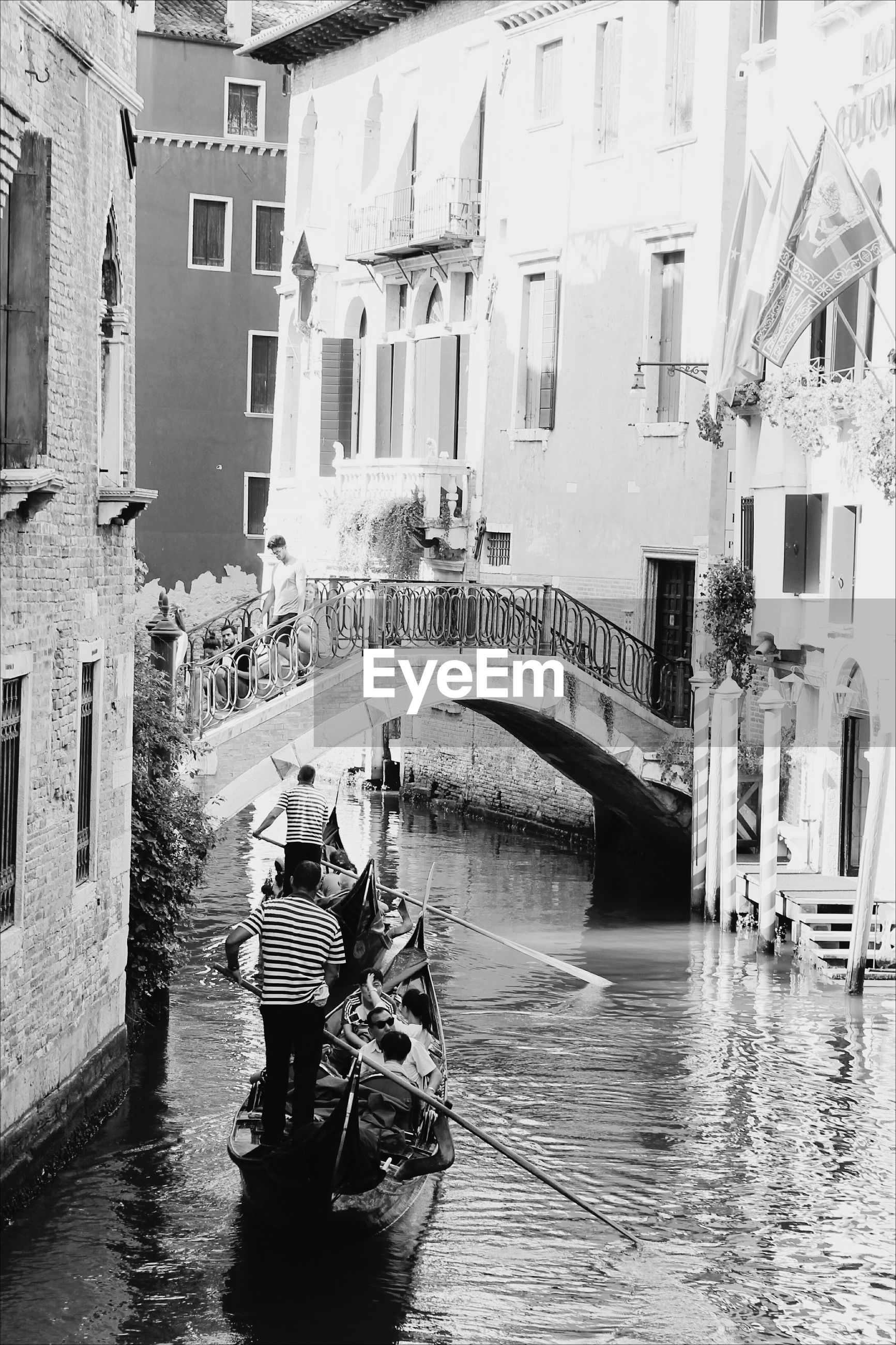 gondola - traditional boat, architecture, building exterior, cultures, water, nautical vessel, built structure, men, outdoors, gondolier, day, people, adult, adults only