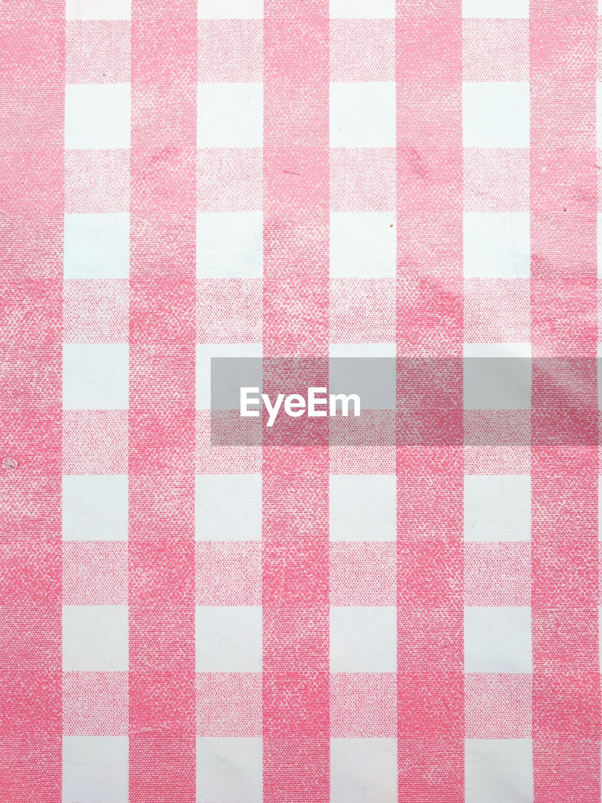 Full frame shot of pink and white square pattern