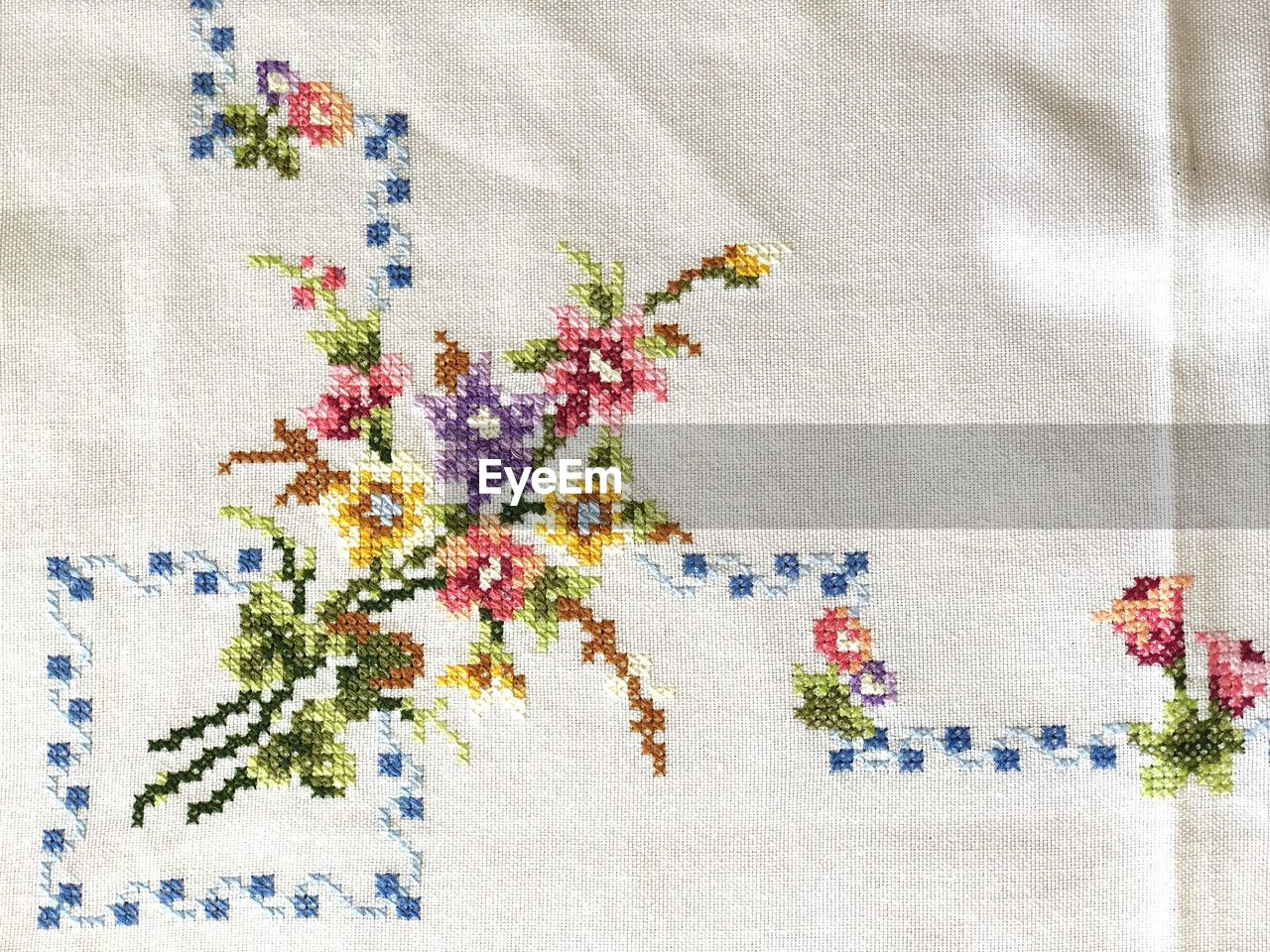 textile, no people, indoors, multi colored, backgrounds, full frame, pattern, creativity, plant, art and craft, close-up, white color, flowering plant, variation, wall - building feature, choice, floral pattern, still life, flower, linen, embroidery