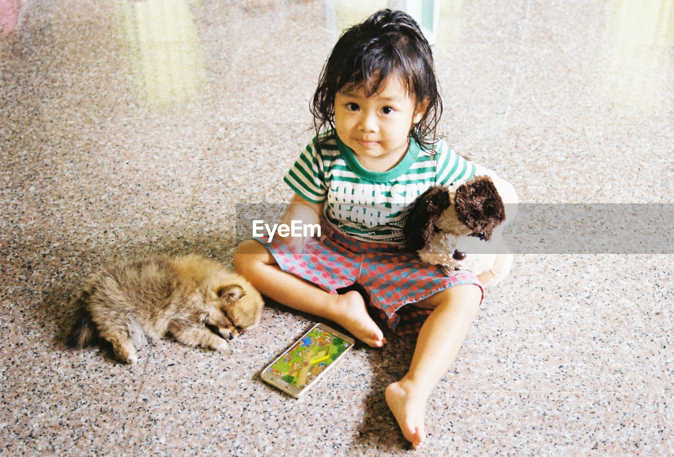 one animal, animal, dog, pets, animal themes, domestic animals, childhood, one person, mammal, people, learning, puppy, full length, outdoors, children only, day, sitting, friendship, child, adult