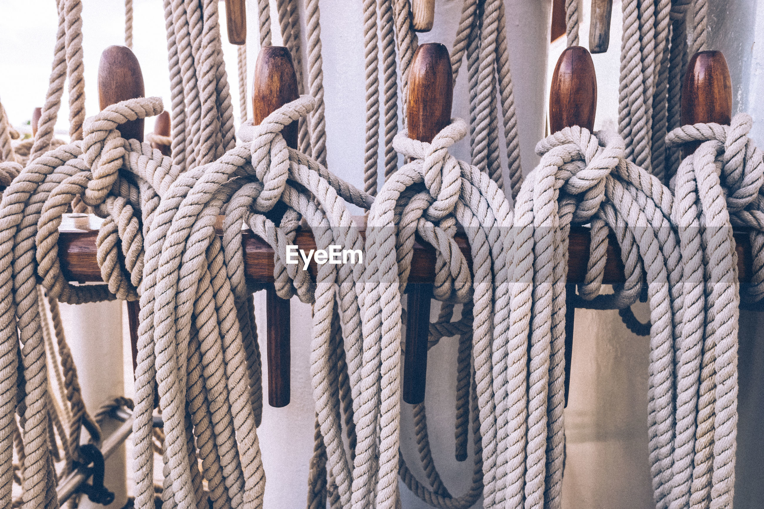 Close-up of rope tied to wood on boat deck