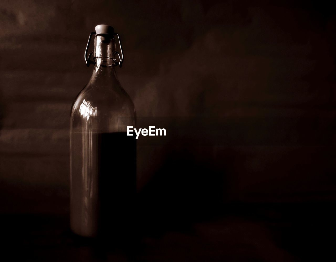 Close-Up Of Empty Bottle In Darkroom