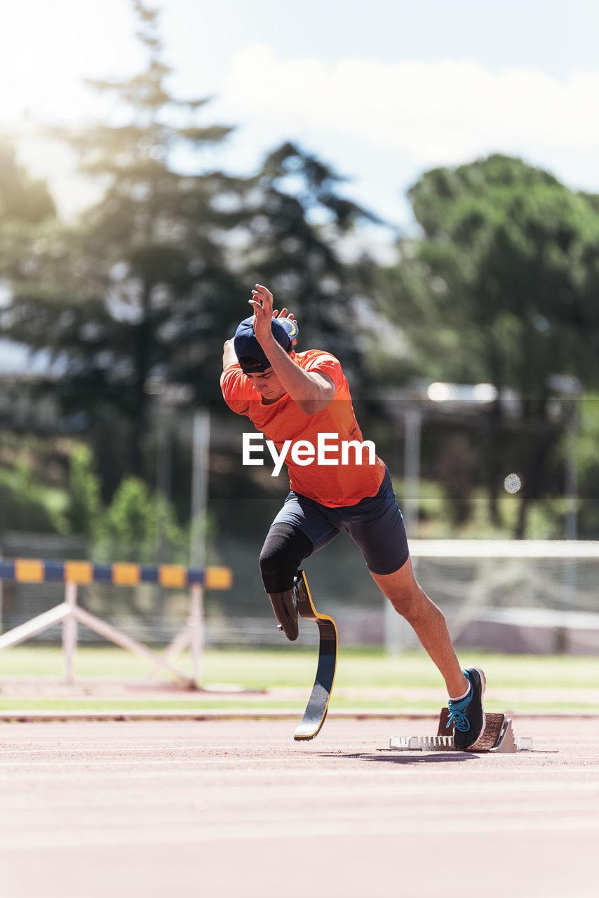 Man with prostethic leg running