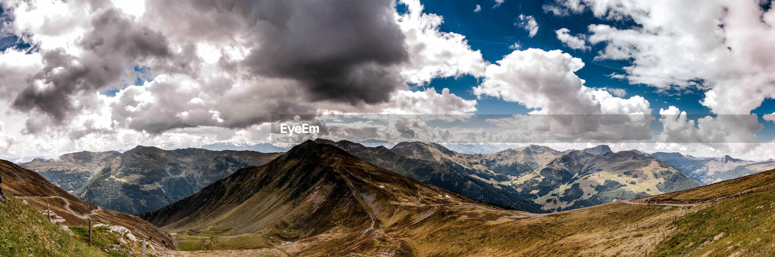 PANORAMIC VIEW OF CLOUDS OVER MOUNTAIN