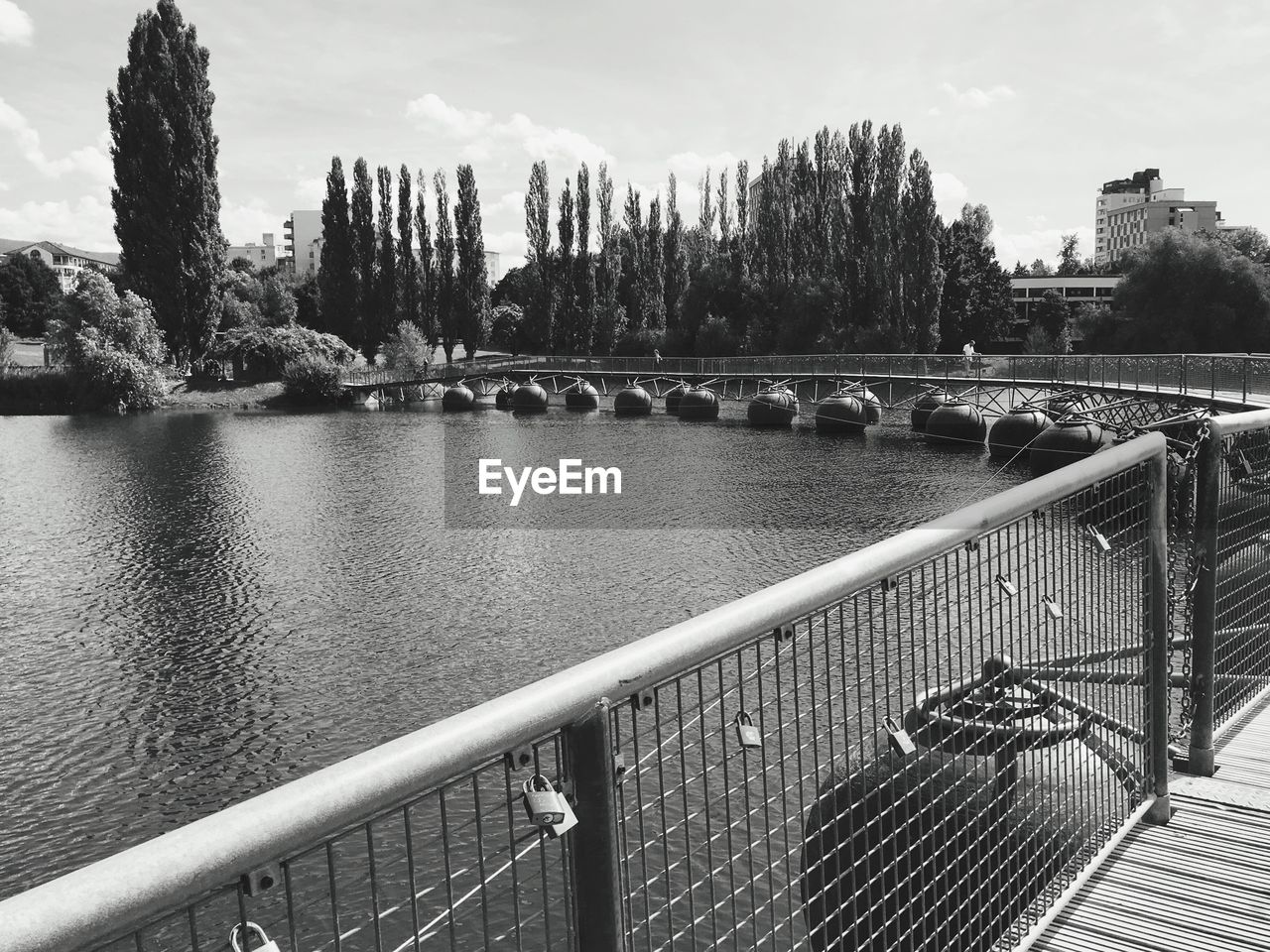 water, architecture, sky, tree, railing, nature, built structure, metal, day, river, no people, bridge, building exterior, plant, outdoors, barrier, bridge - man made structure, connection, balustrade