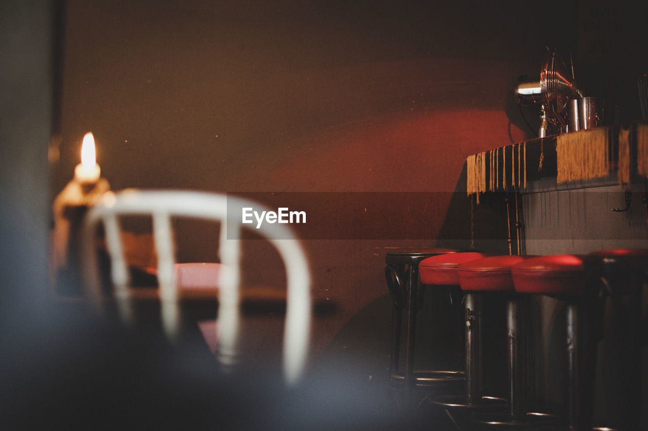 Empty Stools By Bar Counter